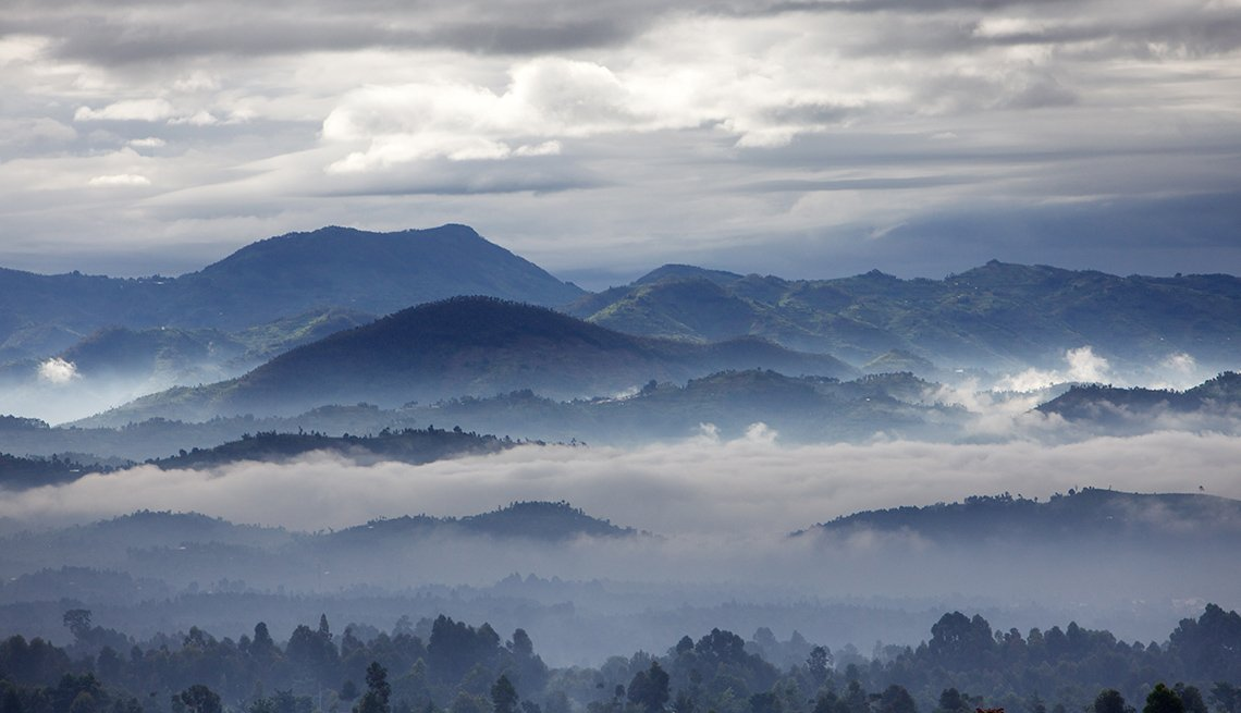 Aerial View Of Mist, Clouds And Sky Over Virunga Volcano In Rwanda, Under The Radar Destinations