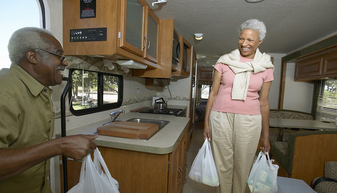 An African American Couple With Groceries Inspect Their RV, Tips From Experienced RV Travelers