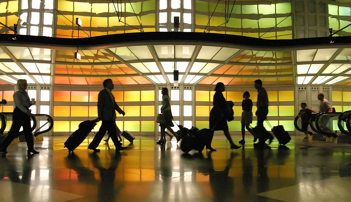 Throngs Of Travelers In Terminal At Airport, Holiday Travel Tips