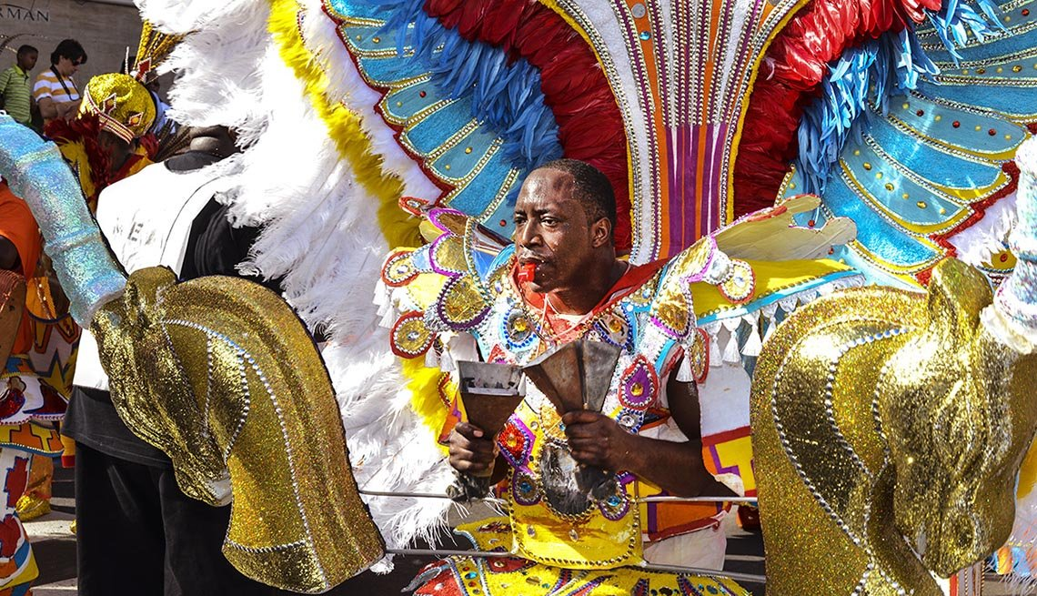 A Man Dressed Up For The Parade In The Bahamas, New Year's Eve Destinations
