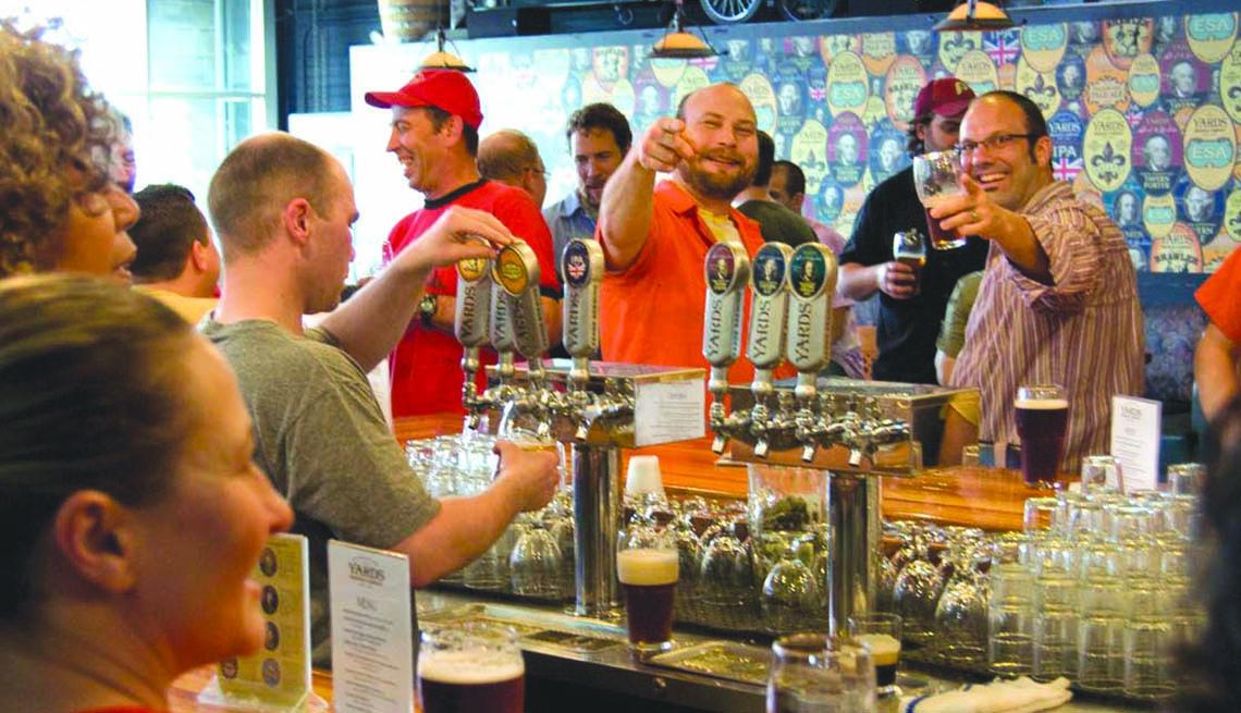 Two Men At Bar Toast Beers In Philadelphia Pennsylvania, Best Cities For Beer Lovers