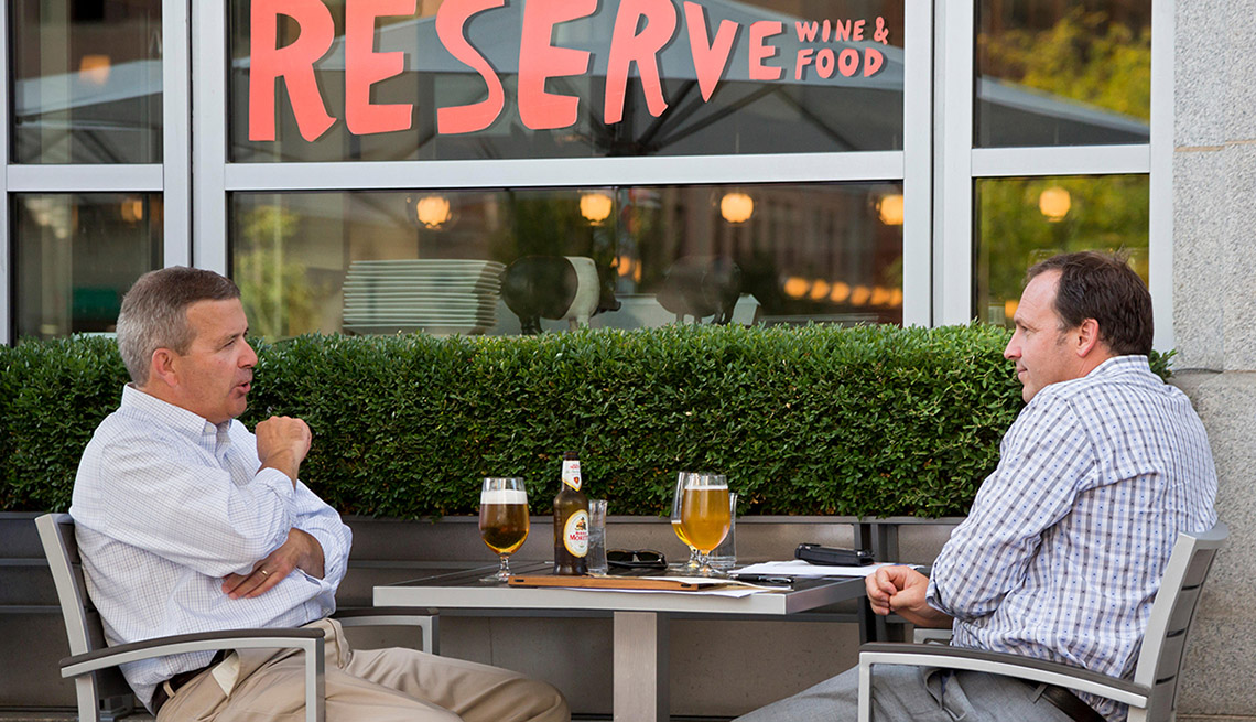 Two Men Enjoy Their Beers Outdoors, Cities For Beer Lovers