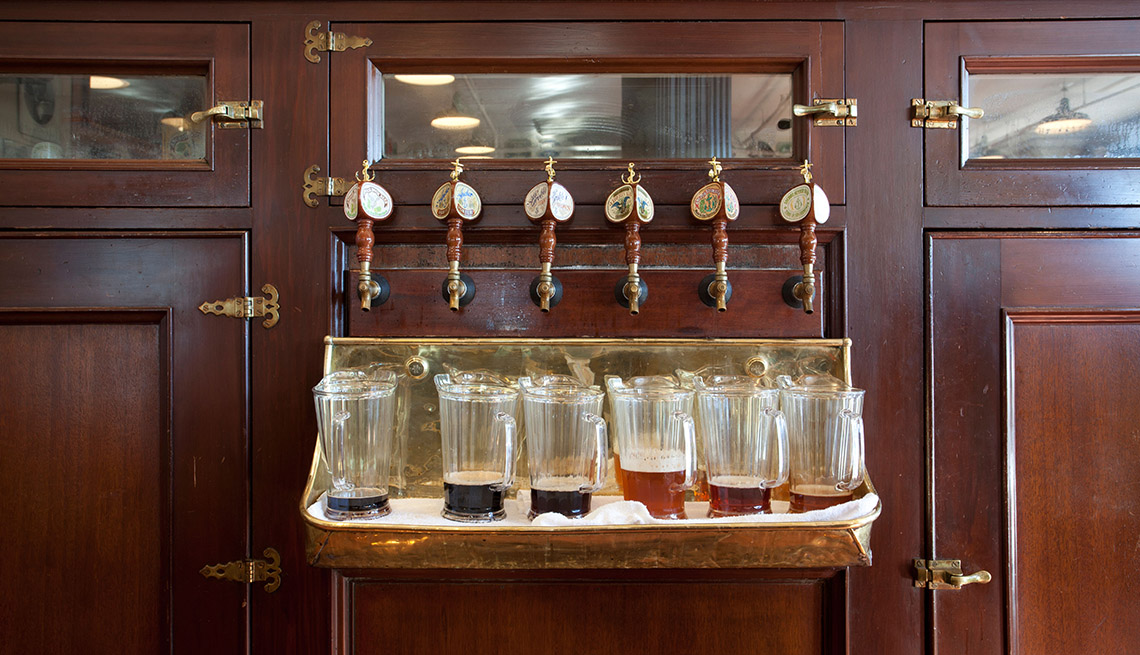Beer Pitchers Sit Below Draft Taps For Numerous Beers On Tap, Best Cities For Beer Lovers