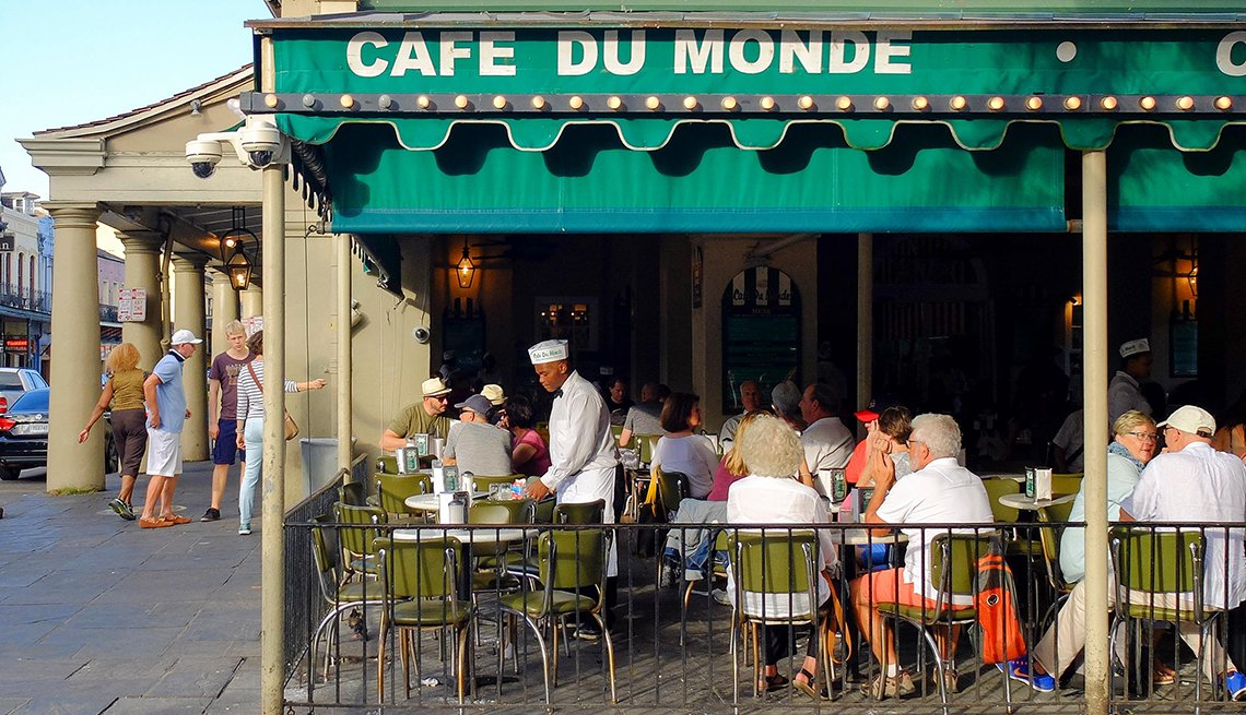 Customers in Outdoor Seating at Cafe du Monde, New Orleans, Great U.S. Getaways for Food Lovers