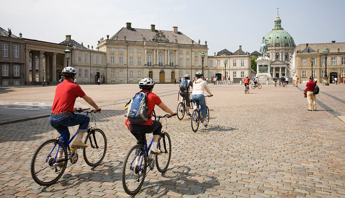 Tourists Ride Bicycles Through Copenhagan Near Amalienborg Palace, How To Choose A Guided Tour