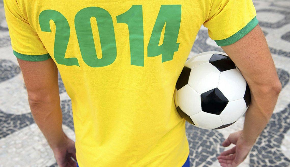 Soccer Player Holds Soccer Ball In Brazil, 10 Summer Destinations
