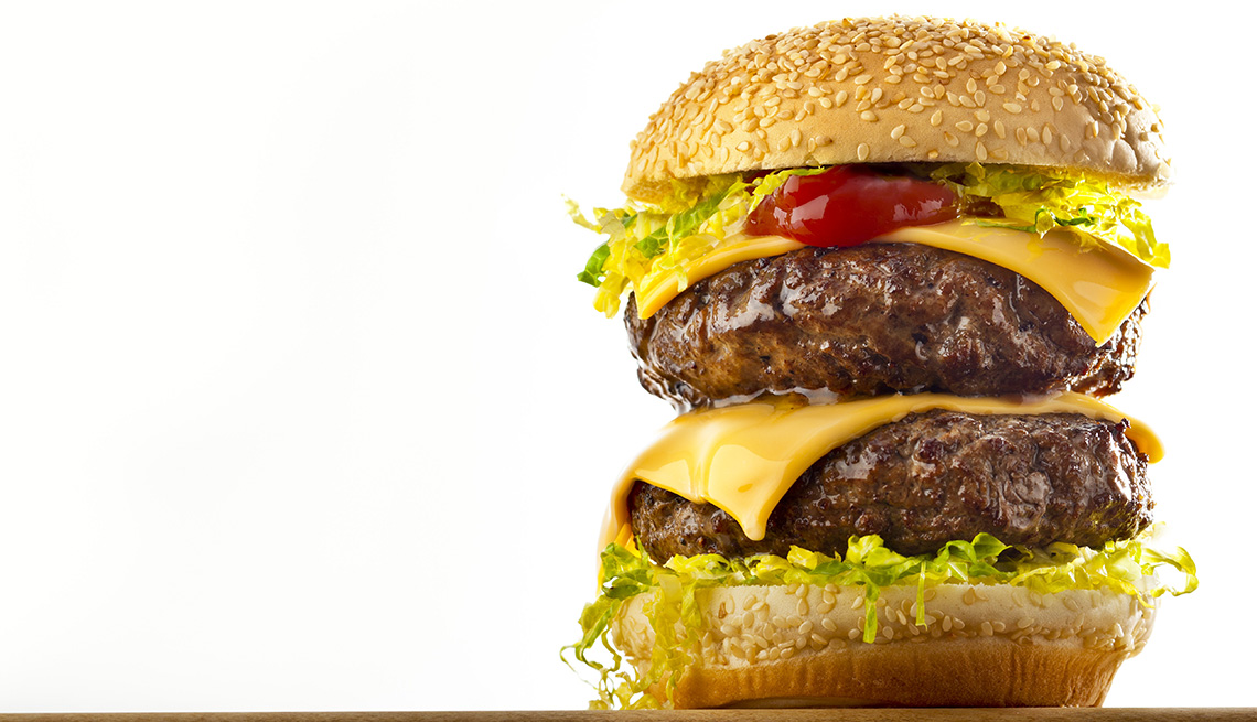 Close Up Of A Two Patty Cheeseburger, Foods To Avoid Before Flying