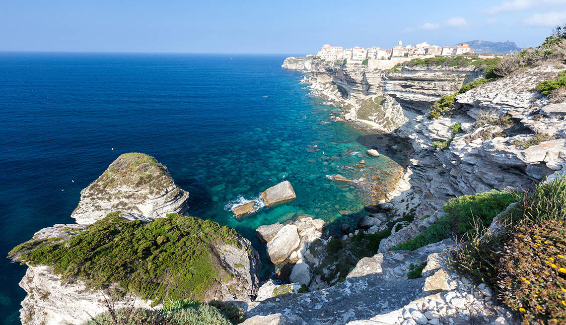 View Of The Dramatic Cliffs Overlooking The Ocean In Corsica, France, World's Best Beaches