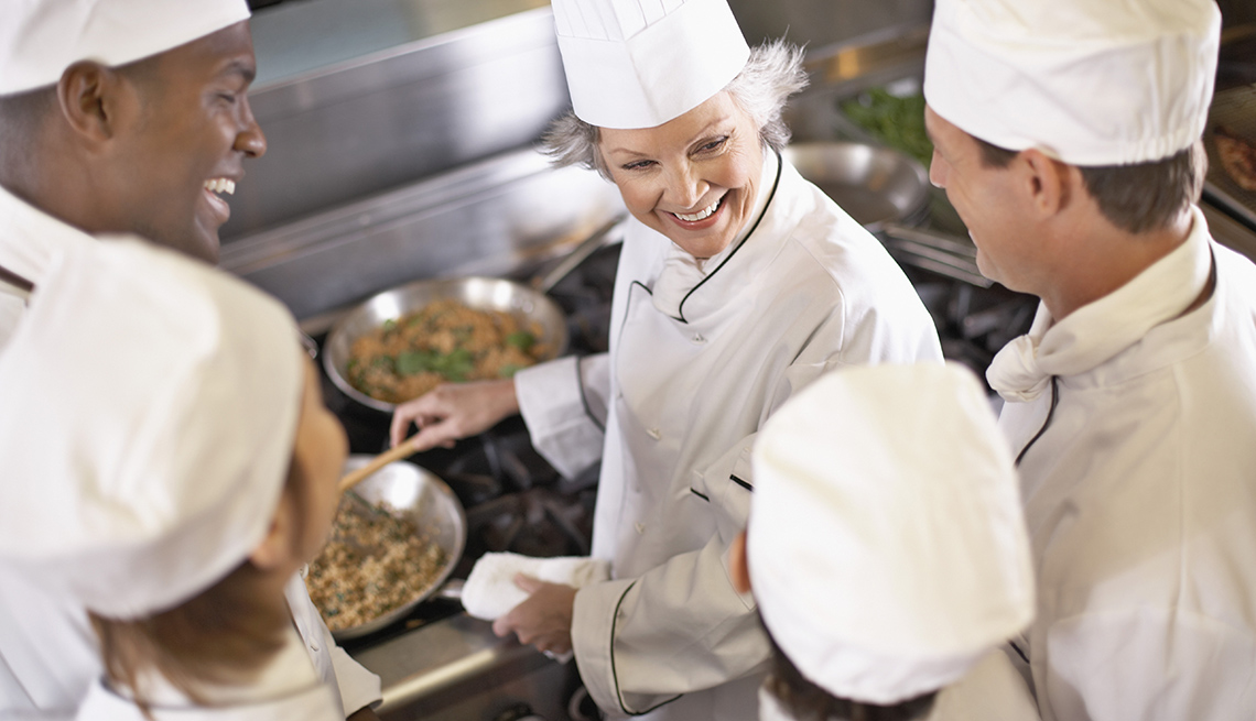 Female Head Chef Demonstrates Cooking Technique To Students, Unique Vacation Ideas
