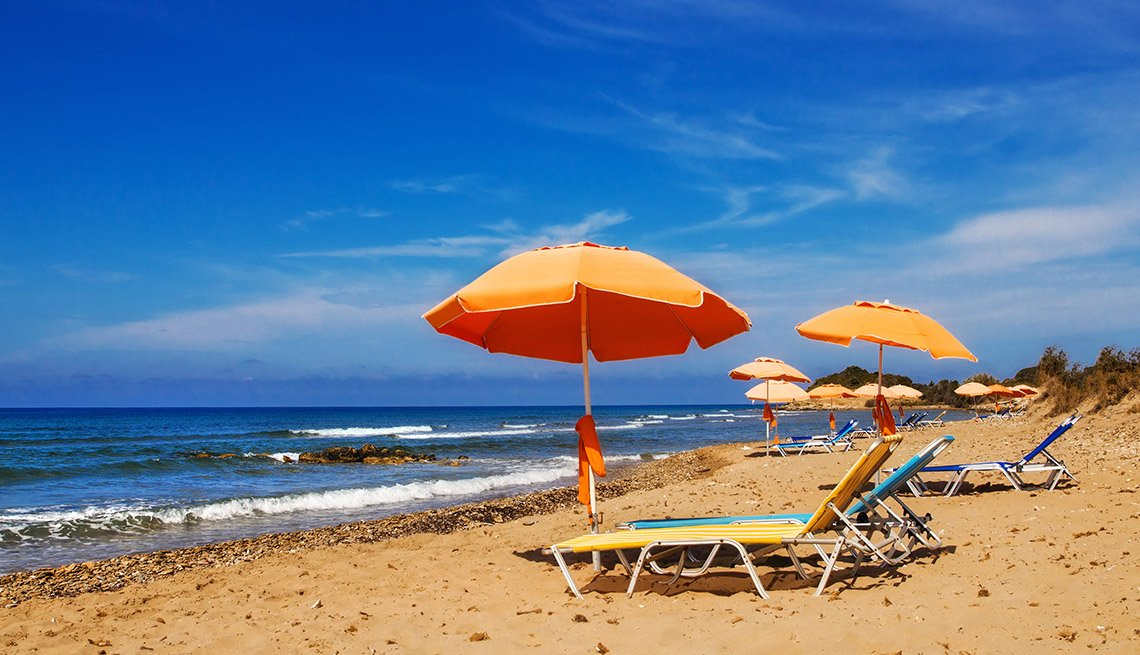 Umbrellas And Beach Chairs On Corfu In Greece, World's Best Beaches
