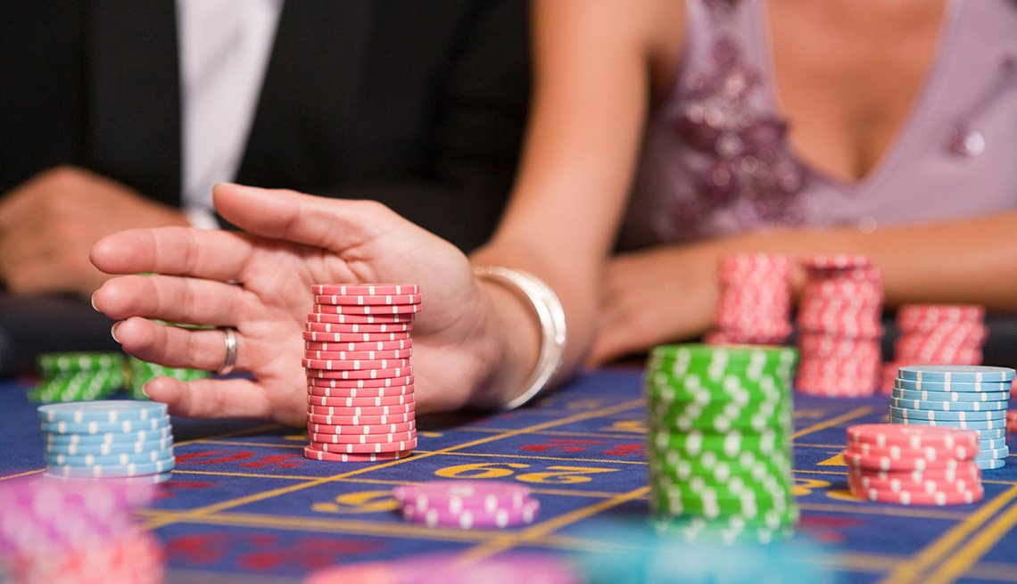 Couple Move Their Chips On Roulette Table, Gambling Trip Tips