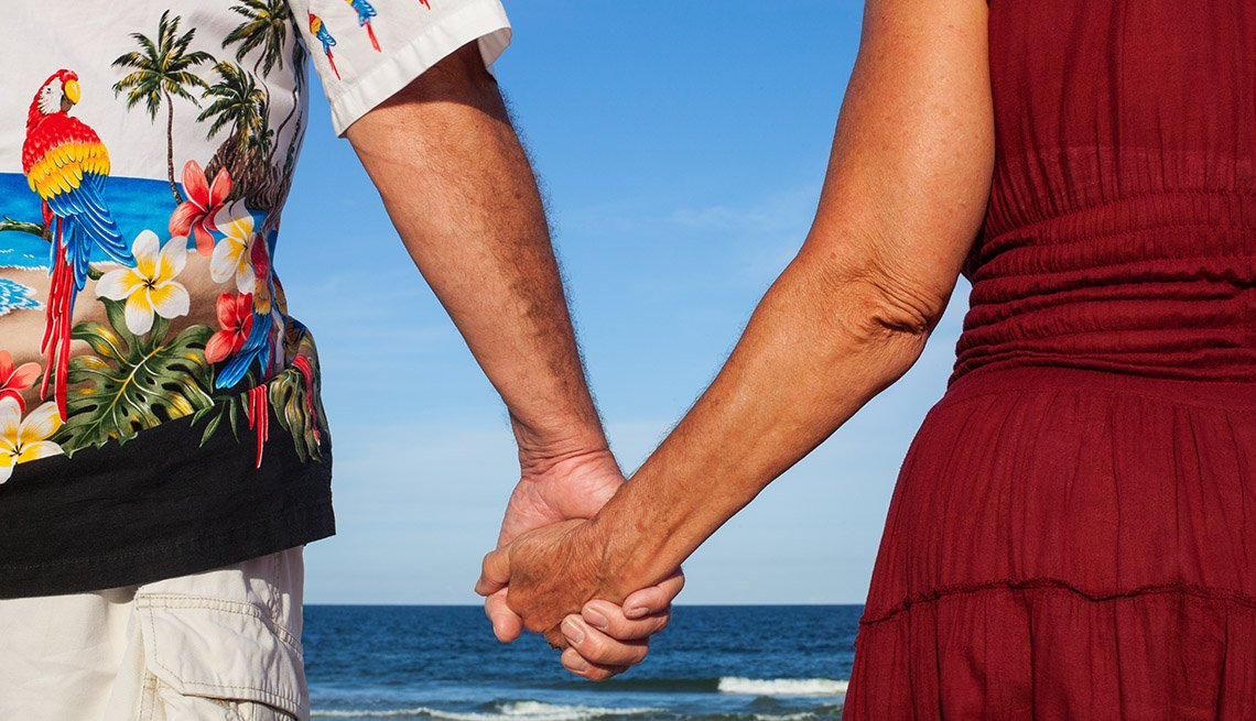 Woman In Red Dress And Man In Hawaiian T Shirt Hold Hands, Cruise Ship Myths