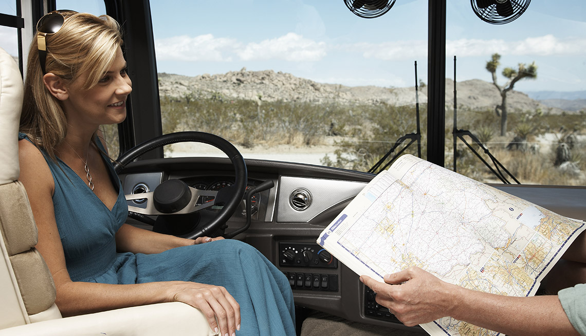 Caucasian Woman Sits In Driver Seat Of RV While Looking At Map With Her Husband, Tips From Experienced RV Travelers
