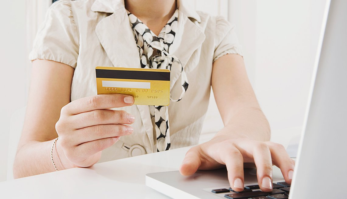 Close Up Of A Woman Holding Credit Card While Using A Laptop, Cruise Ship Guide And Tips