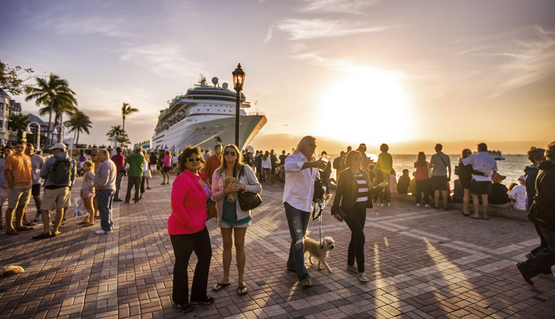 People Hang Out In Front Of Docked Cruise Ship, AARP Traveler's Tips