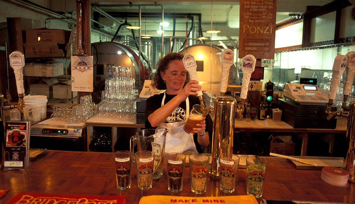 Woman Operates The Tap At A Bar, Best Cities For Beer Lovers
