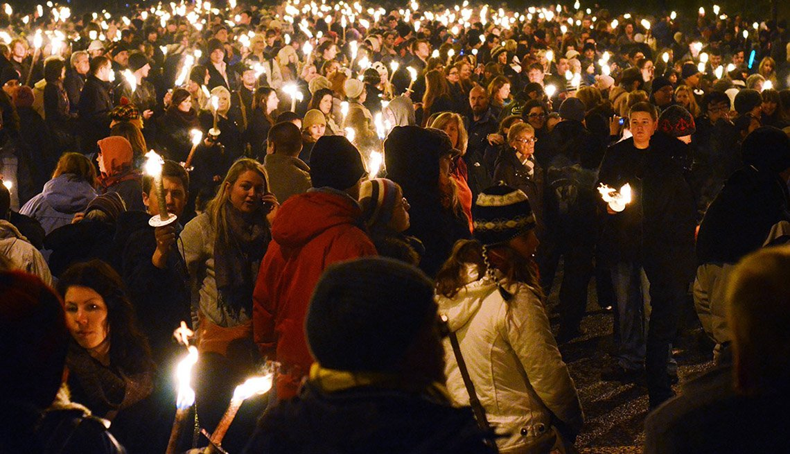 Crowds Gather With Candles In Edingburgh Scotland, New Year's Eve Destinations