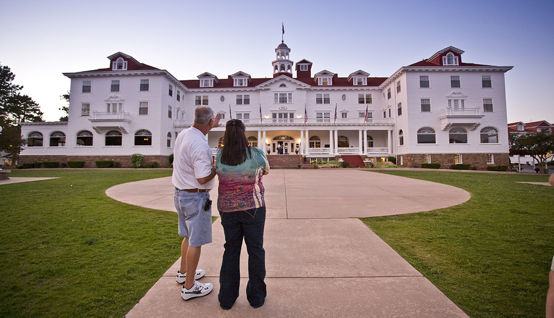 Couple In Front Of The Stanley Hotel In Estes Park Colorado, Second Honeymoon Destinations