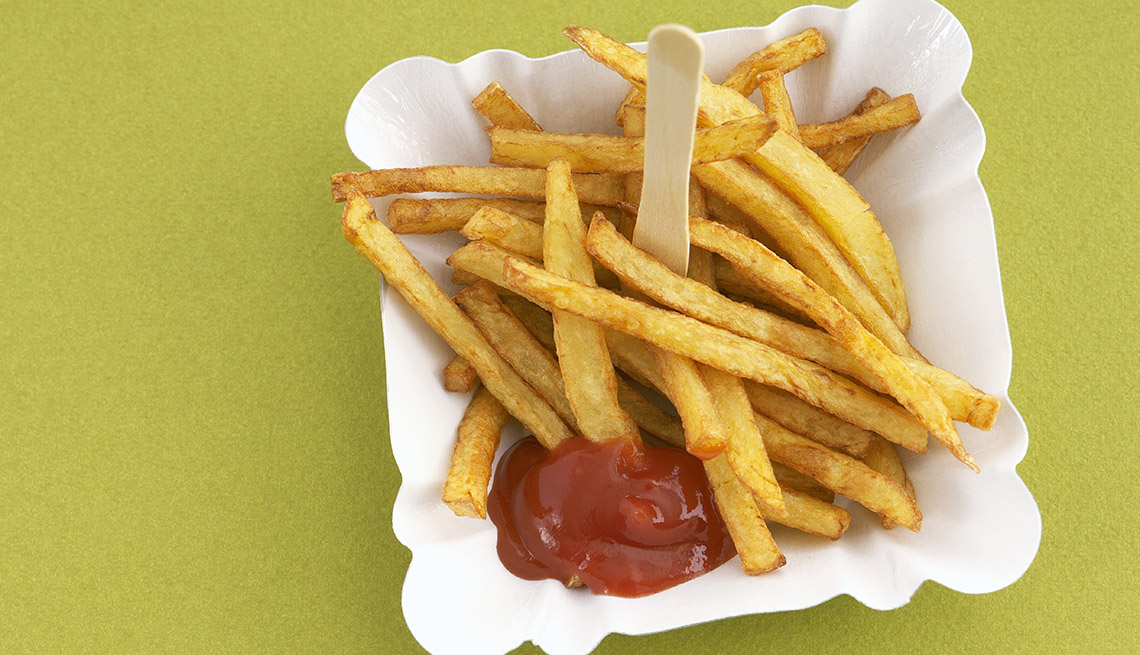 A Plate Of French Fries With Ketchup, Foods To Avoid Before Flying