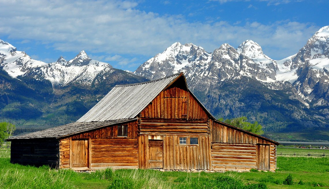 A Wood Cabin In Front Of The Grand Tetons Wyoming, Best National Parks