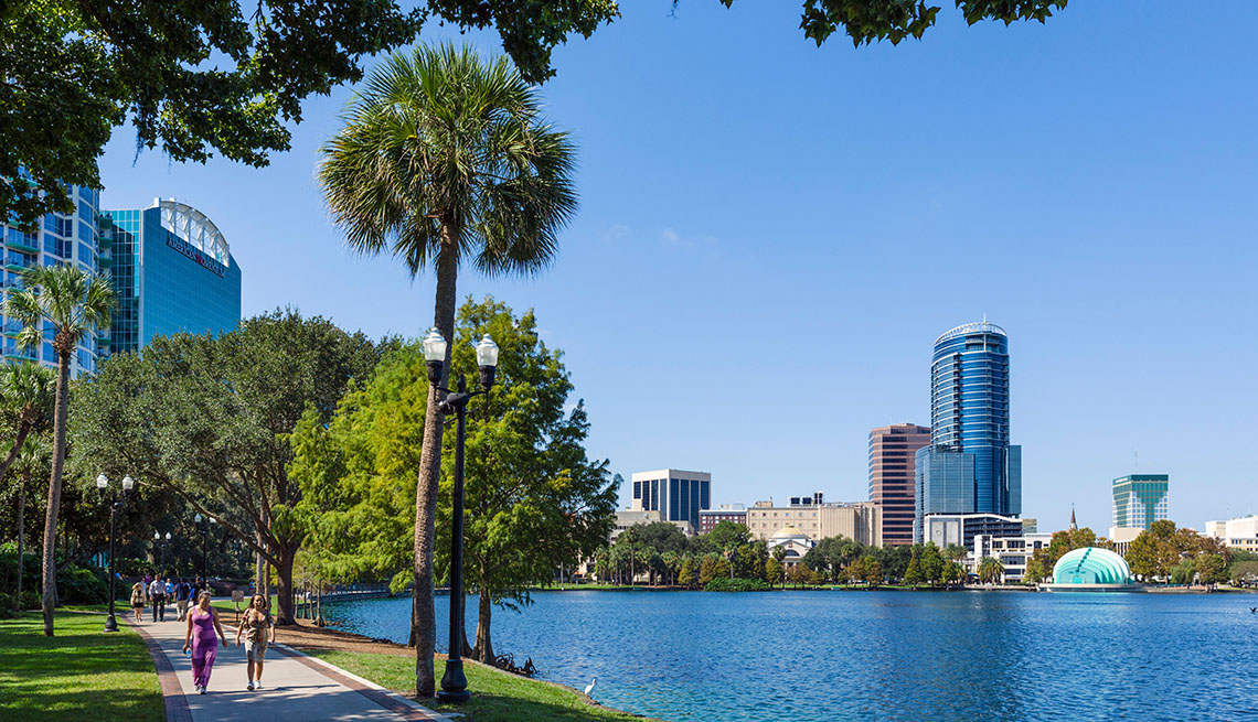 item 10 of Gallery image - People Enjoy The Waterfront By Lake Ecola In Downtown Orlando Florida, Great Fall Vacations