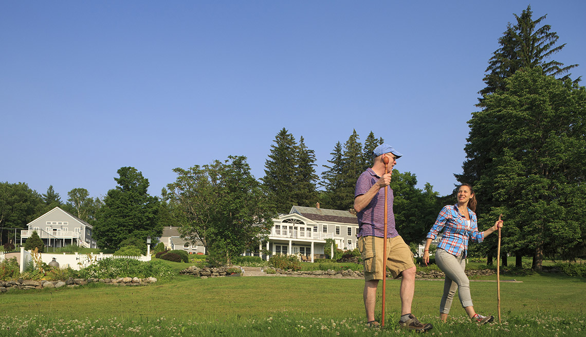Couple With Hiking Sticks In Vermont, Wellness Vacation