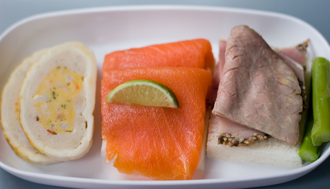 Close Up Of A In Flight Meal Consisting Of Salmon And Roast Beef