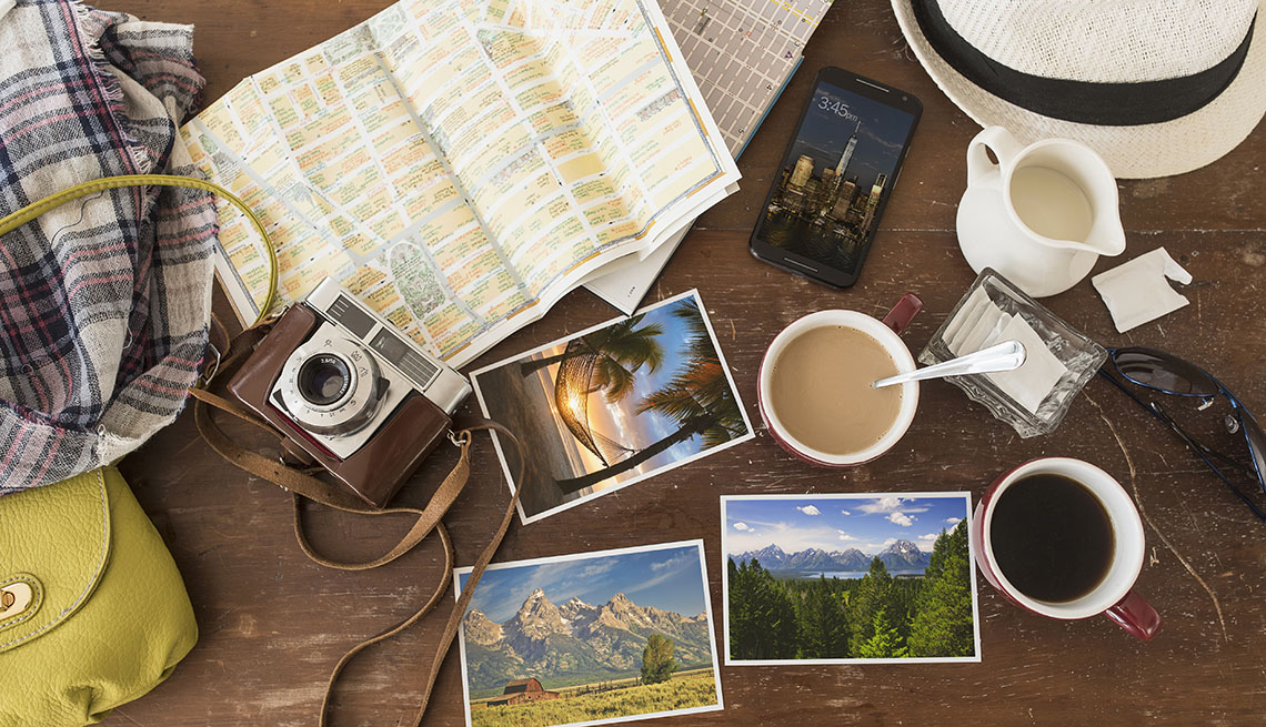 Aerial View Of Table With Camera, Photos, Coffee, Tea And Other Items, Tips From Experienced RV Travelers