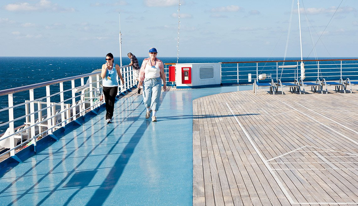 Two Ladies Take A Stroll On The Deck Of A Cruise Ship, Wellness Vacation