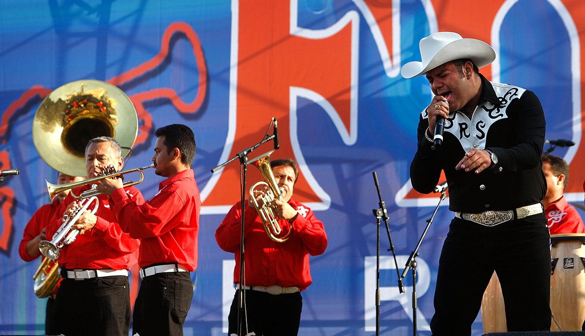 Band Performs On Stage, The Best Latin Festivals In America