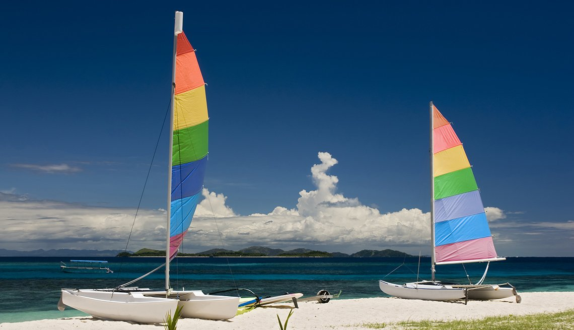 Two Catamarans Sit On The Beach On Mamanuca Beach In Fiji, World's Best Beaches
