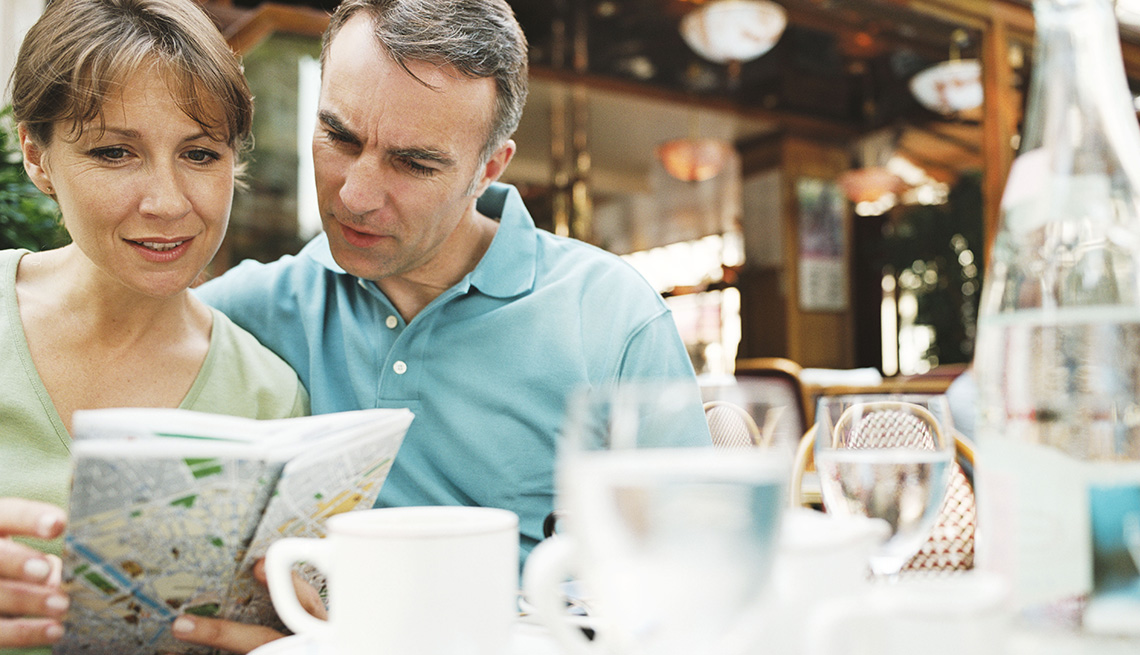 Middle Aged Caucasian Couple Look At Map At Restaurant, How To Save Safe While Traveling