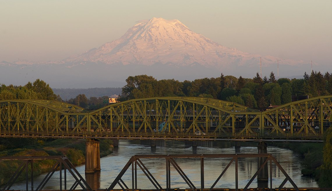 Rail Tracks Over Water With Mount Rainier In The Background, Fall Foliage Trains