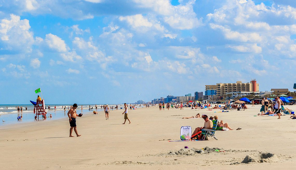 Tons Of Tourists And Locals Enjoy A Sunny Day At The Beach in New Smyrna Florida, Best Beach Towns