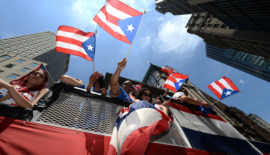 People Wave Flags During The Annual National Puerto Rican Day Parade In New York City, The Best Latin Festivals In America