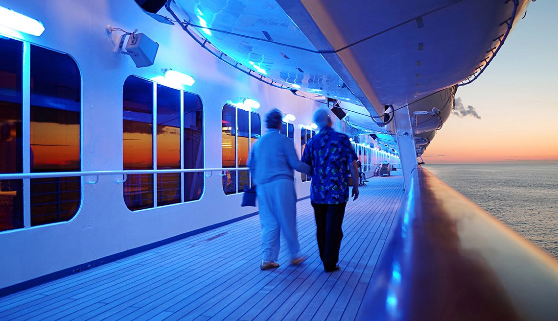 A Senior Couple Holds Hands While Strolling On A Cruise Ship Deck, Cruise Guide And Tips