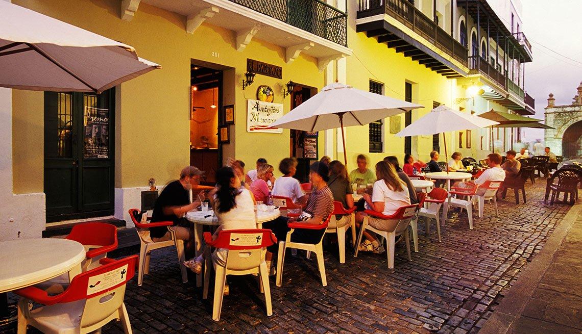 People Enjoy A Meal At Outdoor Restaurant In San Juan Puerto Rico Girlfriend Getaways