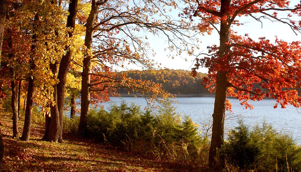 Lake Surrounded By Autumn Trees In The Ozarks In Missouri, Best Fall Foliage Spots In America