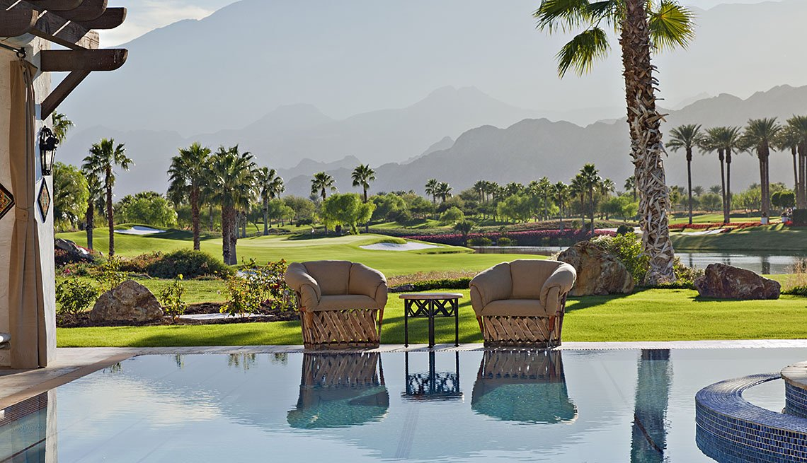 View Of Swimming Pool, Palm Trees And Mountains In Palm Springs California, Second Honeymoon Destinations
