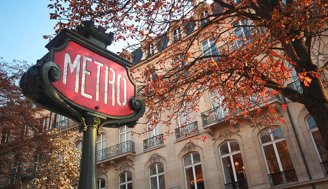 item 5 of Gallery image - A Classic Metro Sign In Front Of A Building In Paris France, Fall Vacations