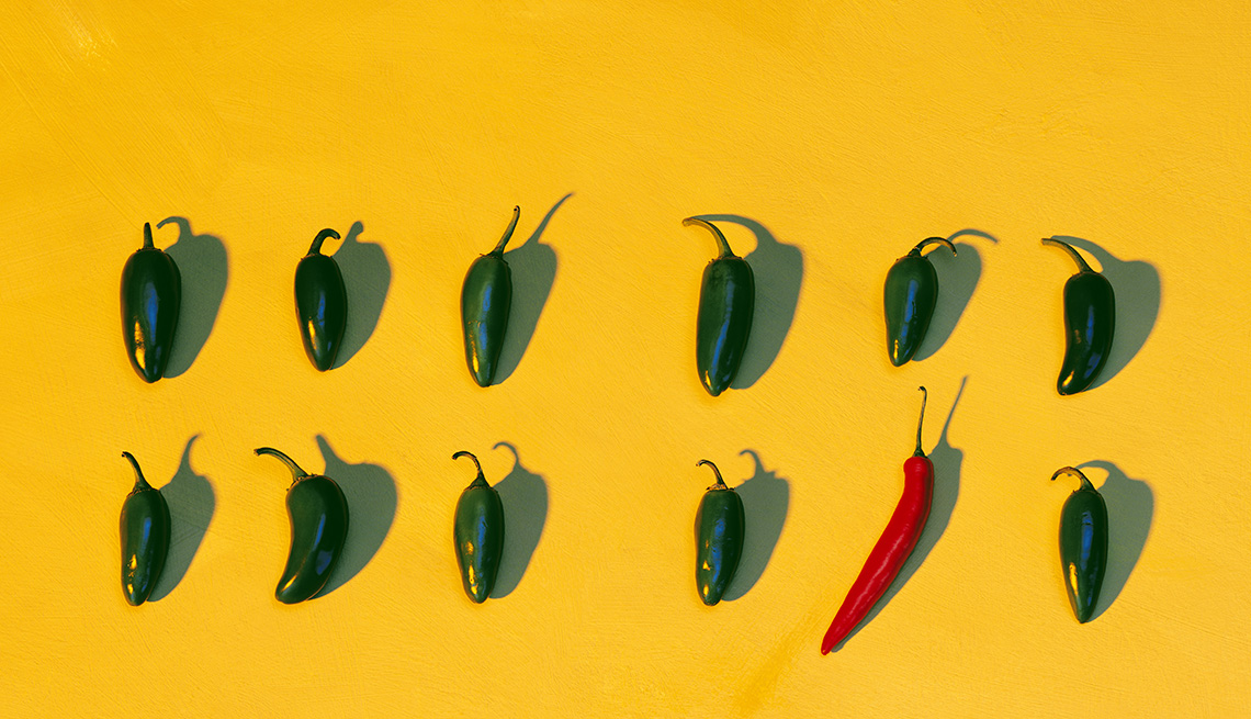 A Line Of Hot Peppers And One Lone Red Pepper On Bright Yellow Background, Foods To Avoid Before Flying