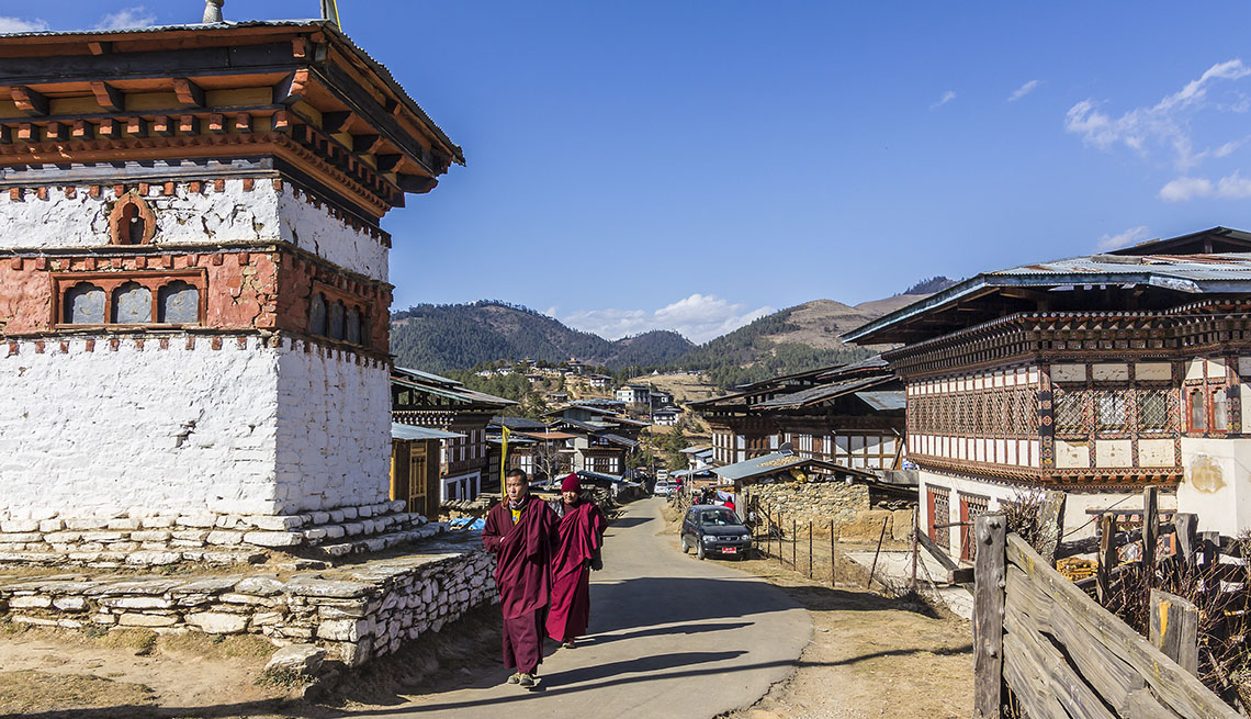 item 11 of Gallery image - Two Monks Walk Through Gangtey Village In Phobjikha In Bhutan, Fall Vacations