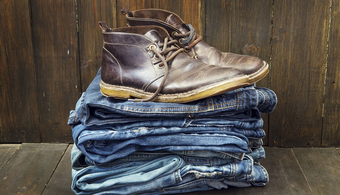 Pair Of Leather Boots On Top Of Pile Of Jeans, AARP Traveler's Tips
