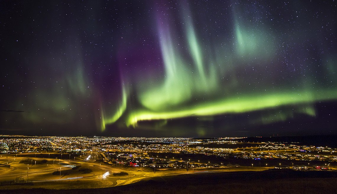 View Of The Aurora Borealis In Reykjavik Iceland, Thanksgiving Day Destinations