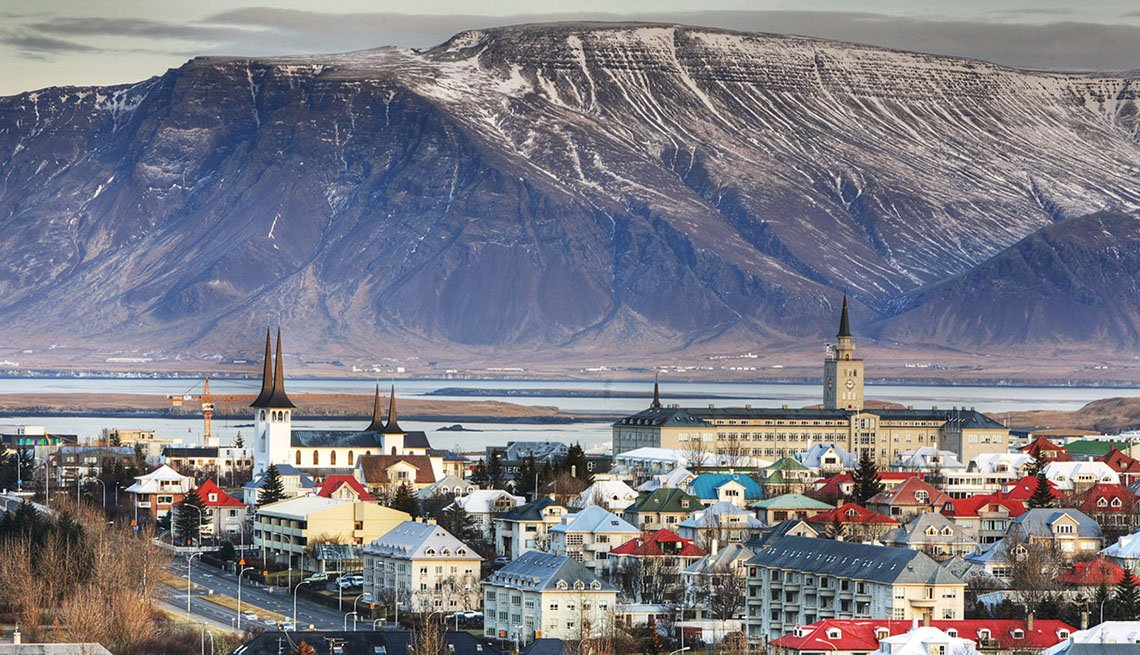 View Of The Town Of Reykjavik Iceland With Mountains In Background, New Year's Eve Destinations