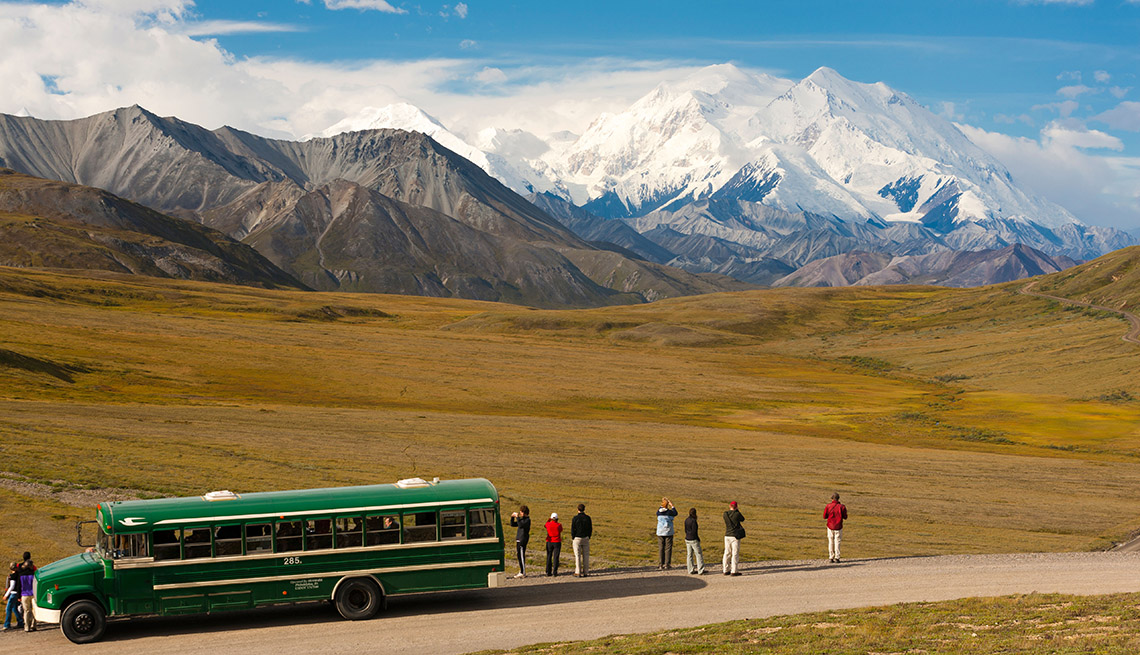 Tourists Stop And Take Photos On The Side Of A Road, Bus Tour Pros