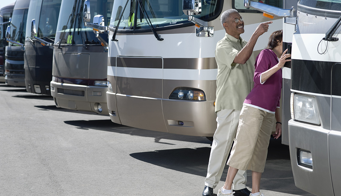 Couple Looks At Different RV Models In Lot, Tips From Experienced RV Travelers