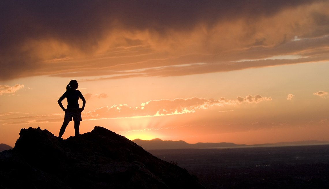 Silhouette Of A Female Hiker On Peak In Wasatch Mountains In Utah Near Salt Lake City, Best Sunsets