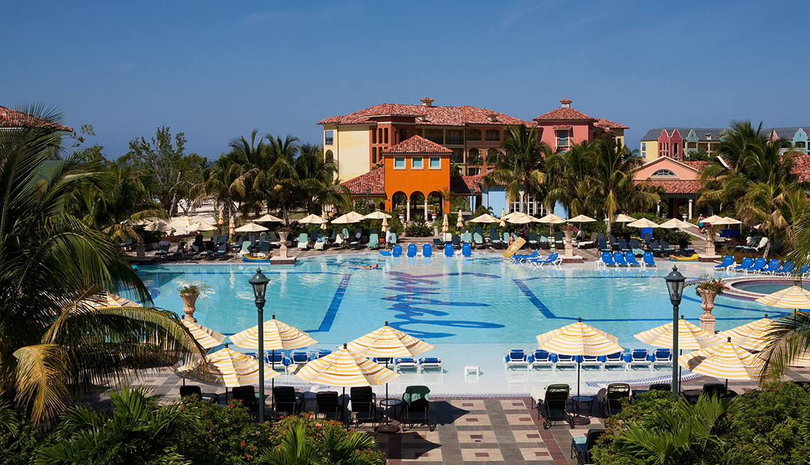 View Of The Pool And Hotel In Background At A Sandals Resort, Second Honeymoon Destinations