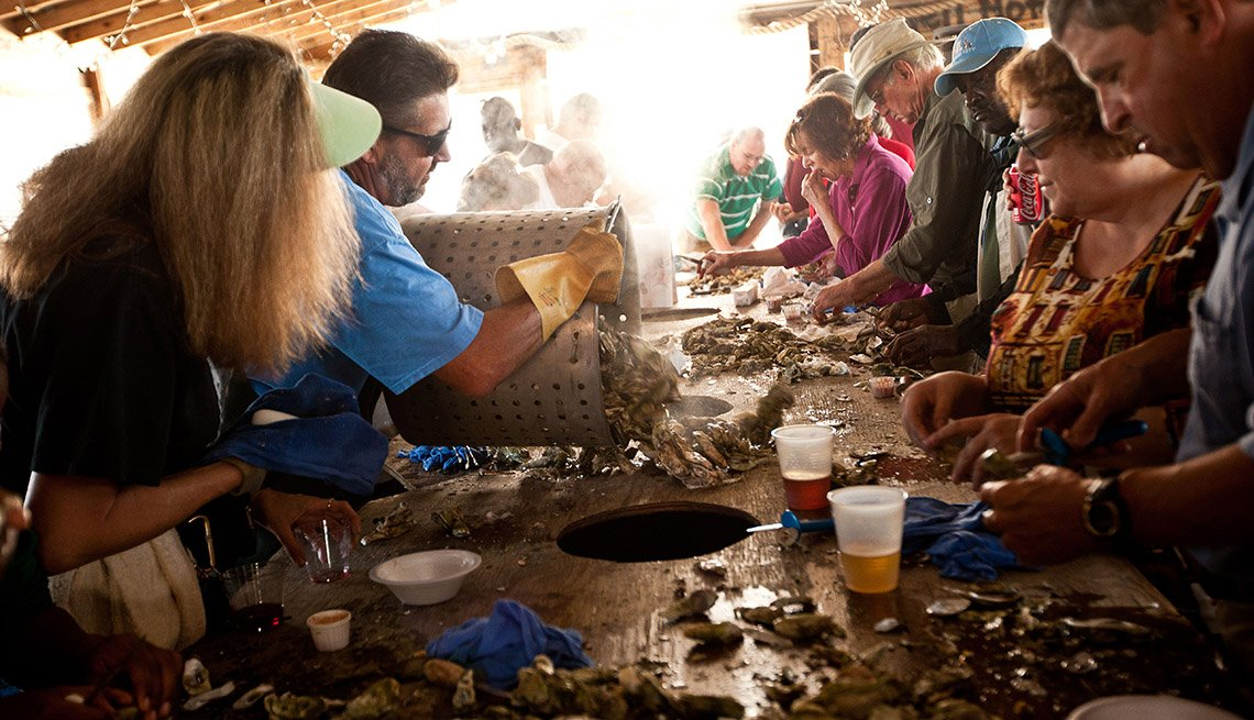 Fresh Oysters Are Dumped Onto A Communal Table In Folly River Charleston South Carolina, Girlfriend Getaways